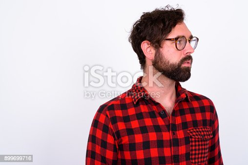 istock Portrait Of Handsome Bearded Man With Blue Eyes Against White Background 899699716