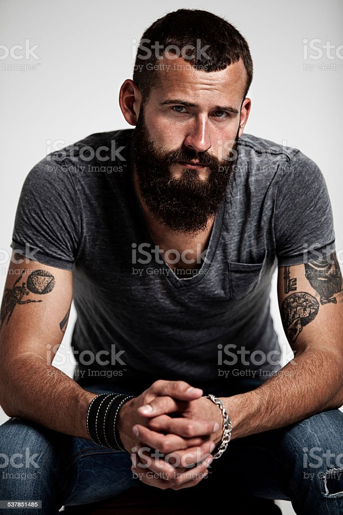 Portrait of handsome bearded man with tattoos stock photo