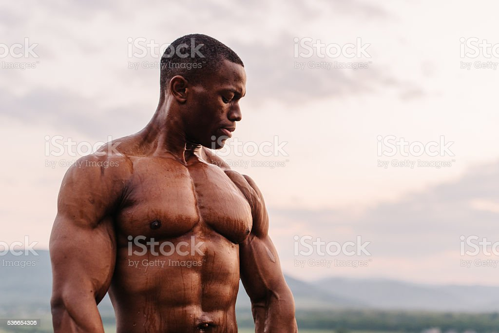 Portrait of handsome black african american athlete on the sunrise stock photo
