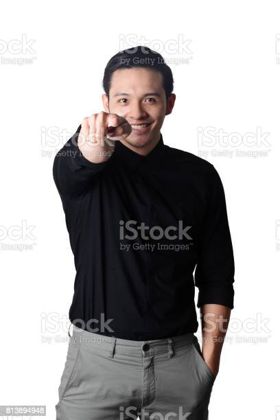 Portrait of handsome business man isolated with fingers sign