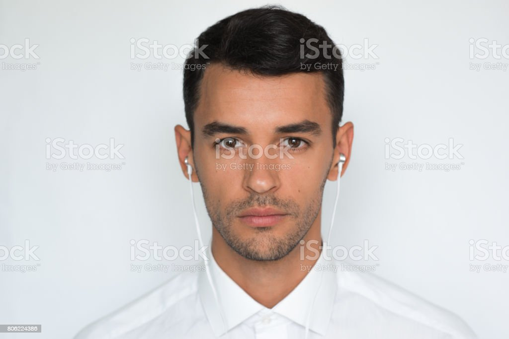 Portrait Of Handsome Caucasian Young Man Enjoying His Favorite Music