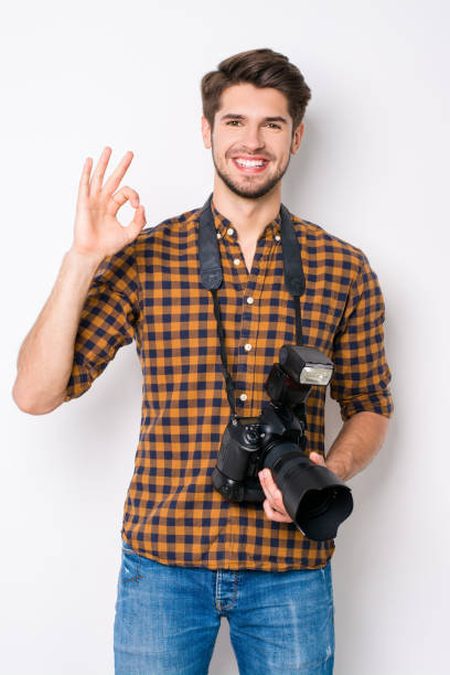 Portrait of handsome cheerful photographer with camera gesturing ok picture id949457960?b=1&k=6&m=949457960&s=612x612&w=0&h=9lqonjfah0b82tpcv4oybtck3fu 6  ueminqo5bbma=
