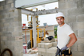 portrait of handsome construction worker on building industry construction site