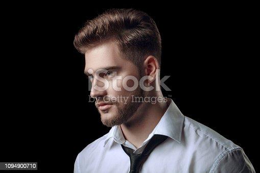 istock Portrait of handsome man in a studio on a dark background 1094900710