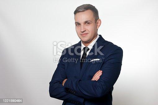 906807208 istock photo Portrait of handsome man in black blue suit 1221590464