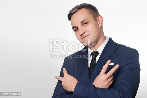 906807208 istock photo Portrait of handsome man in black blue suit 1221590491