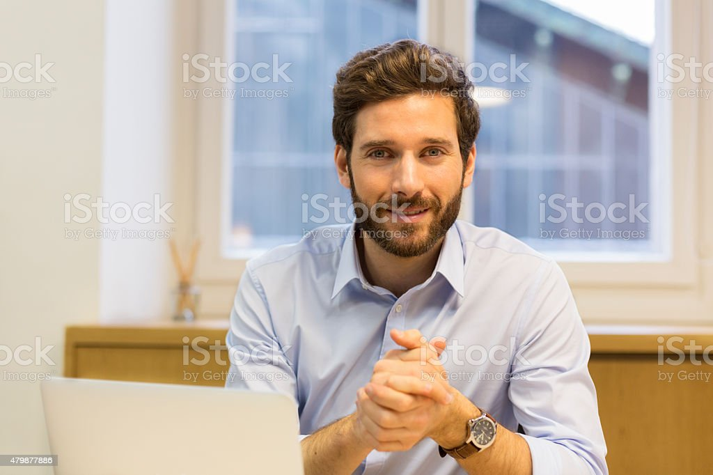 Portrait of handsome man in office royalty-free stock photo