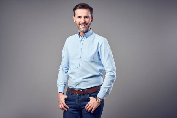 Portrait of handsome man in shirt smiling isolated stock photo