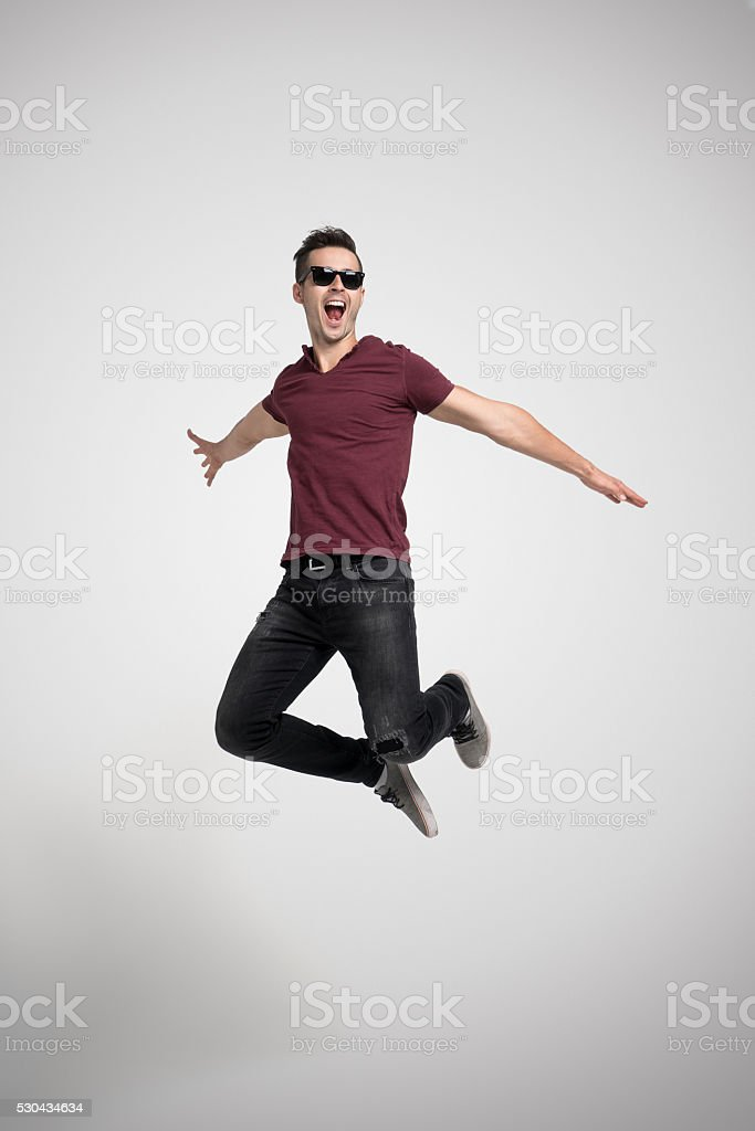 Portrait of handsome man jumping stock photo