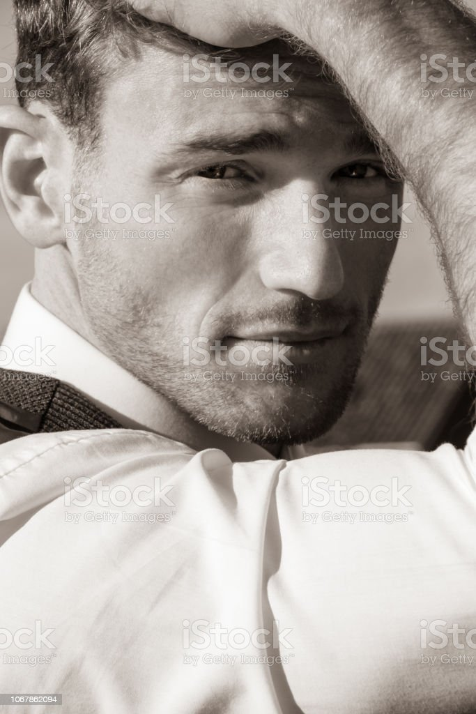 Portrait of handsome man looking wearing shirt and waistcoat looking at camera stock photo