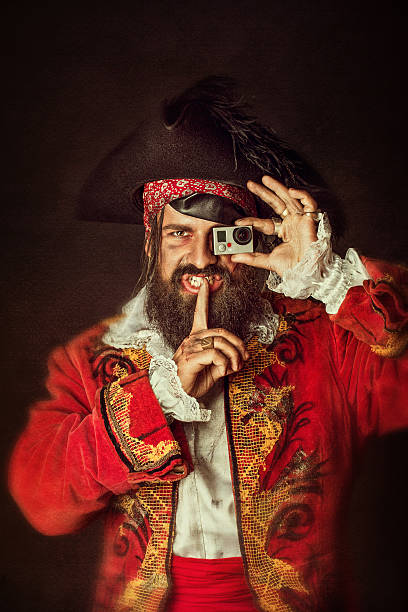 Portrait of handsome man smiles in a pirate costume stock photo