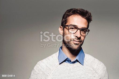 istock Portrait of handsome man wearing eyeglasses 858134814