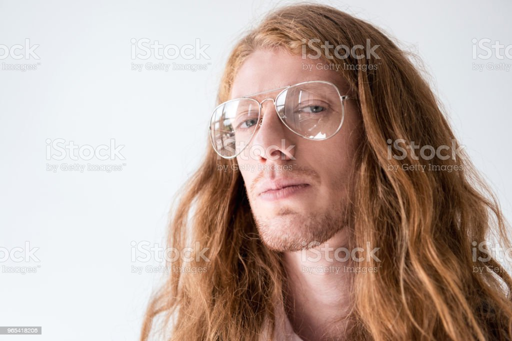 portrait of handsome man with curly ginger hair and glasses looking at camera isolated on white zbiór zdjęć royalty-free