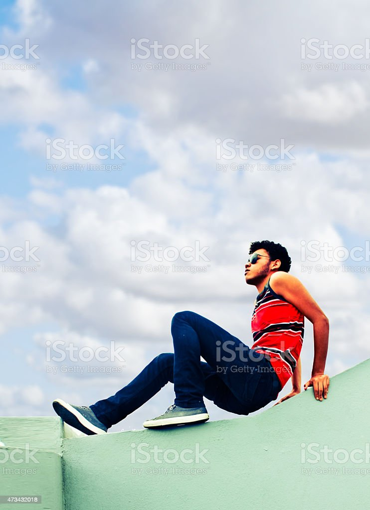 Portrait of handsome man with curly hairstyle in urban background stock photo