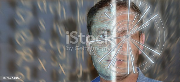 istock Portrait of handsome man with tech pattern on eye and wireframe on the half of a face. Digital ID concept, eye recognition, biometric identification 1074754952