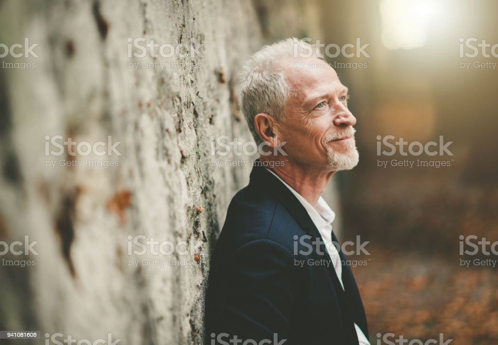 Portrait of handsome mature man, light effect stock photo
