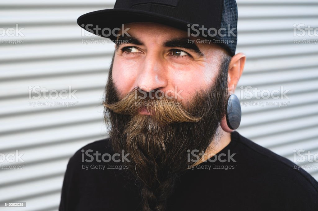 Portrait of handsome men with mustache and braided beard wearing black cap 232631bce39