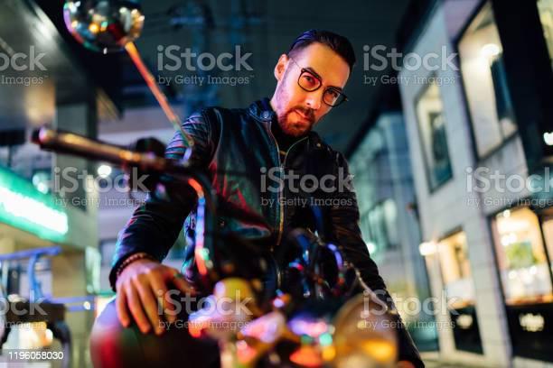 Portrait of handsome motorbike rider at night picture id1196058030?b=1&k=6&m=1196058030&s=612x612&h=7zjfuuhgbudefpeahlzdvm7ktxohqgf8wxvd1ut7kou=