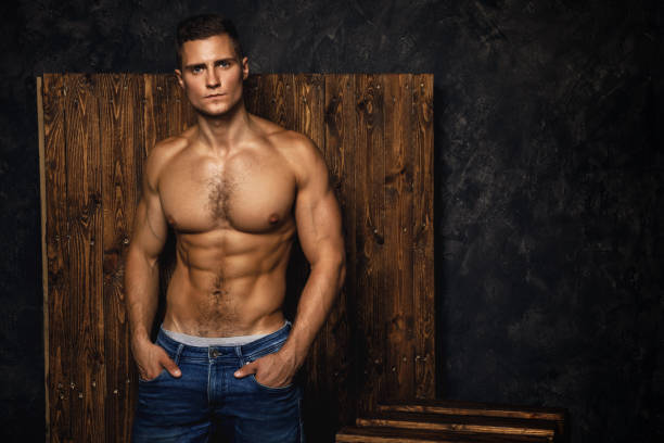 portrait of handsome muscular and sexy man wearing jeans - a petto nudo foto e immagini stock