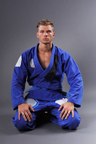 portrait of handsome muscular jiu jitsu fighter posing. - six pack trainer stock-fotos und bilder