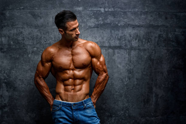 portrait of handsome muscular men outside - man city exercise abs foto e immagini stock