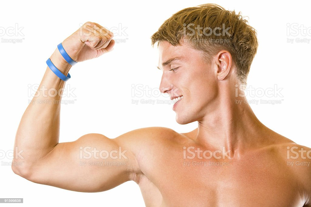Portrait of handsome muscular young man flexing biceps, isolated royalty-free stock photo