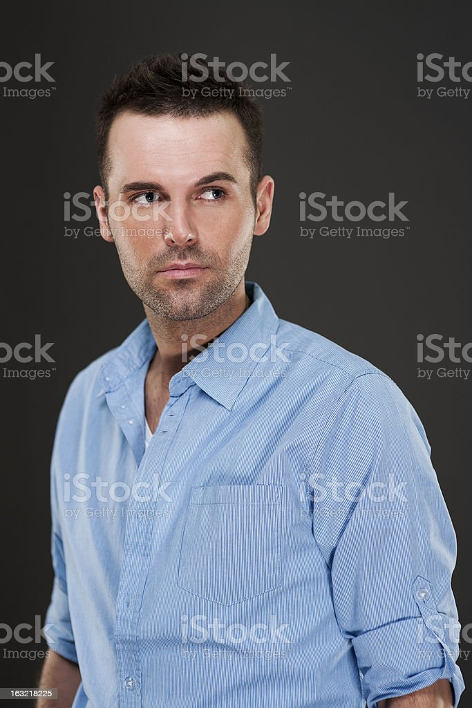 Portrait of handsome pensive man royalty-free stock photo