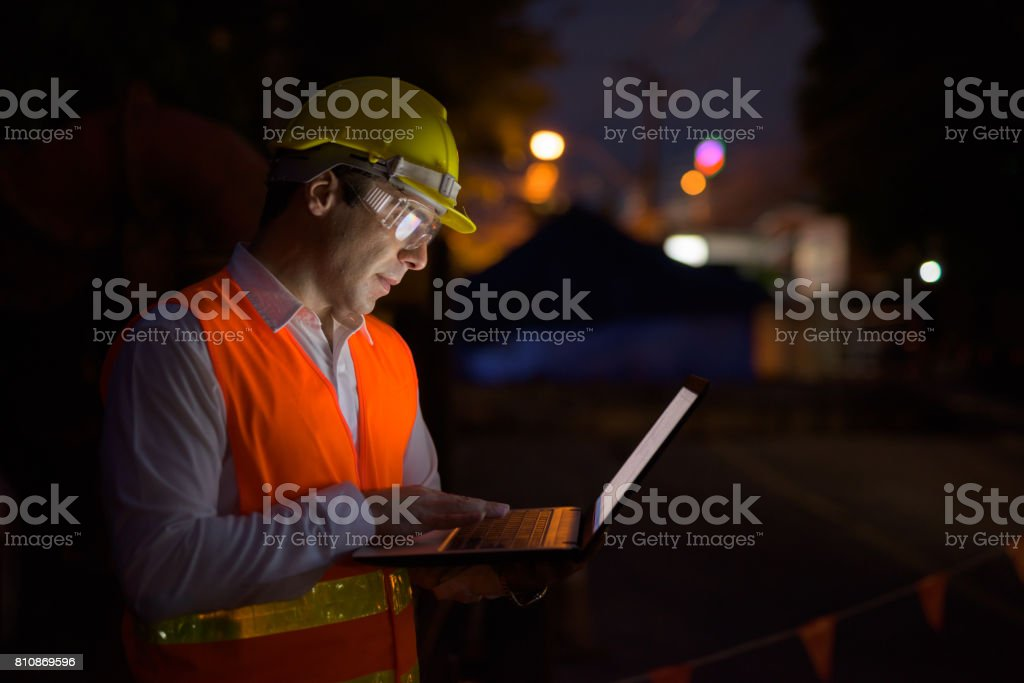 Portrait of handsome Persian man construction worker on the construction site at night Portrait of handsome Persian man construction worker on the construction site at night horizontal shot 30-39 Years Stock Photo