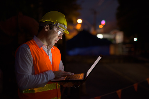 Portrait Of Handsome Persian Man Construction Worker On The Construction Site At Night Stock Photo - Download Image Now