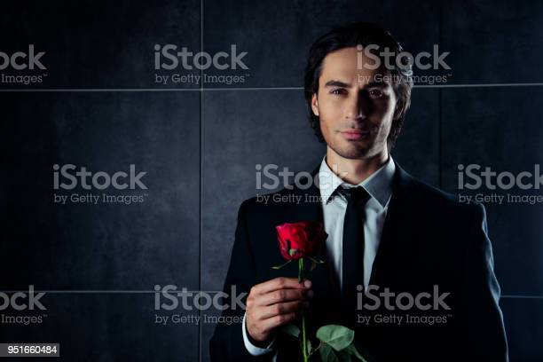 Portrait of handsome romantic young man in formalwear holding red picture id951660484?b=1&k=6&m=951660484&s=612x612&h=t0hsmzoo0cjmdjdkqclelgsf1lcwrrslrwqmsqrpaky=