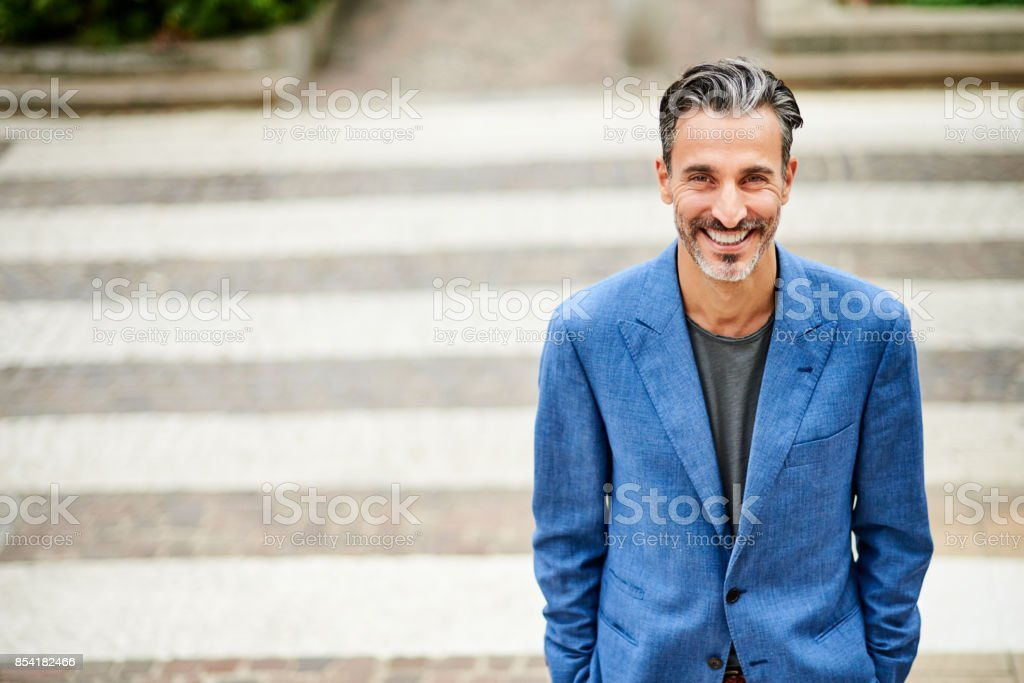 Portrait of handsome smiling man stock photo