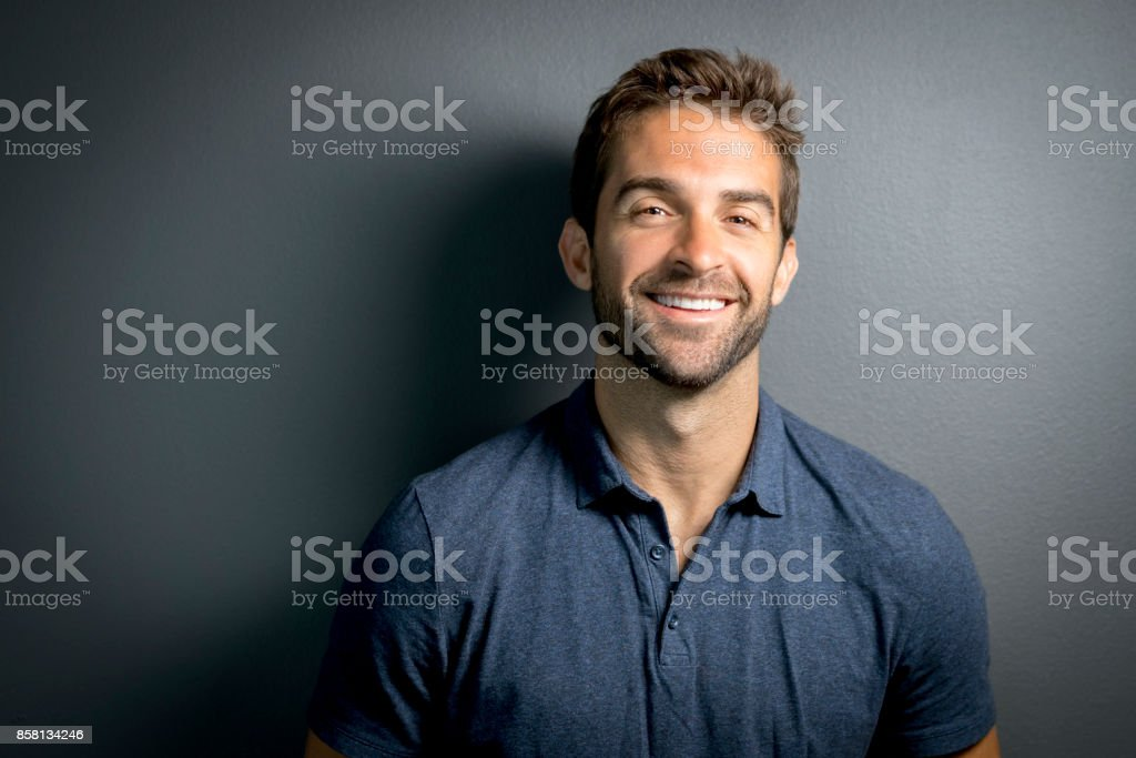 Portrait of handsome smiling mid adult man stock photo