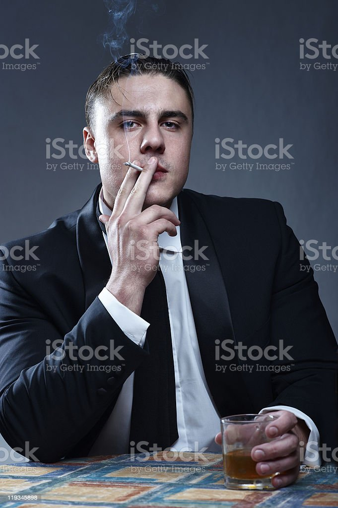Portrait of handsome smoking young man with stock photo