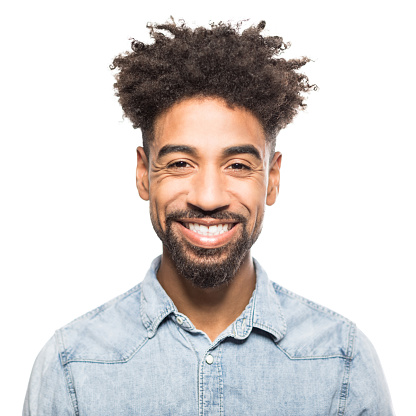 Portrait of handsome young african man smiling against white background