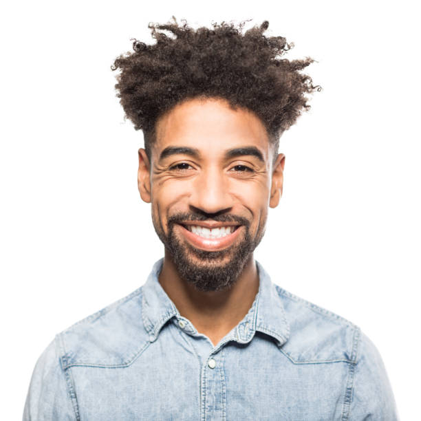 Portrait of handsome young african man smiling stock photo