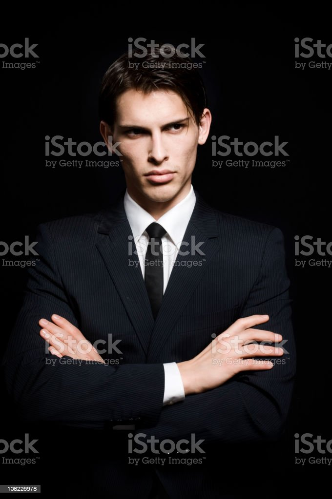 Portrait of Handsome Young Man Wearing Suit, On Black Background royalty-free stock photo