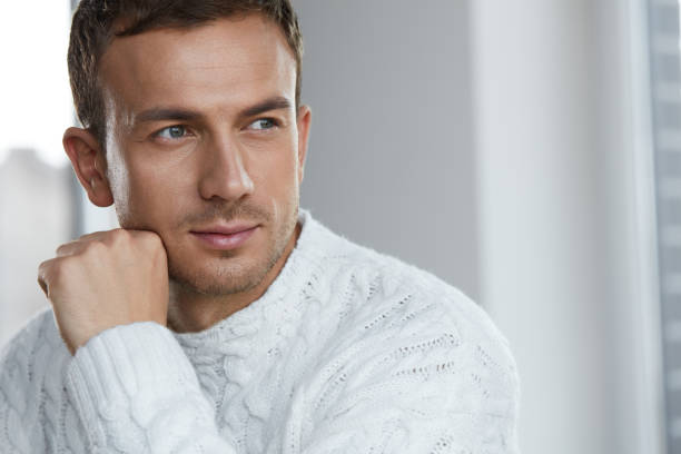 portrait of handsome young man with beautiful face, soft skin - handsome people stock pictures, royalty-free photos & images