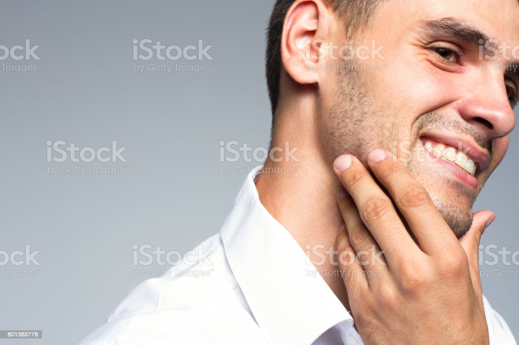 Portrait of handsome young man with clean face and happy smile stock photo