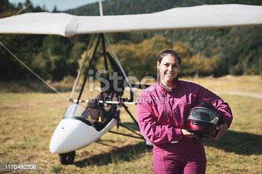 Portrait of beautiful woman hang glider pilot outdoor.