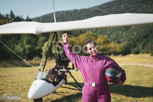 Portrait of beautiful woman hang glider pilot outdoor.