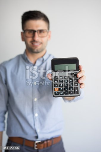 istock Portrait of happy accountant in glasses showing calculator 954120290