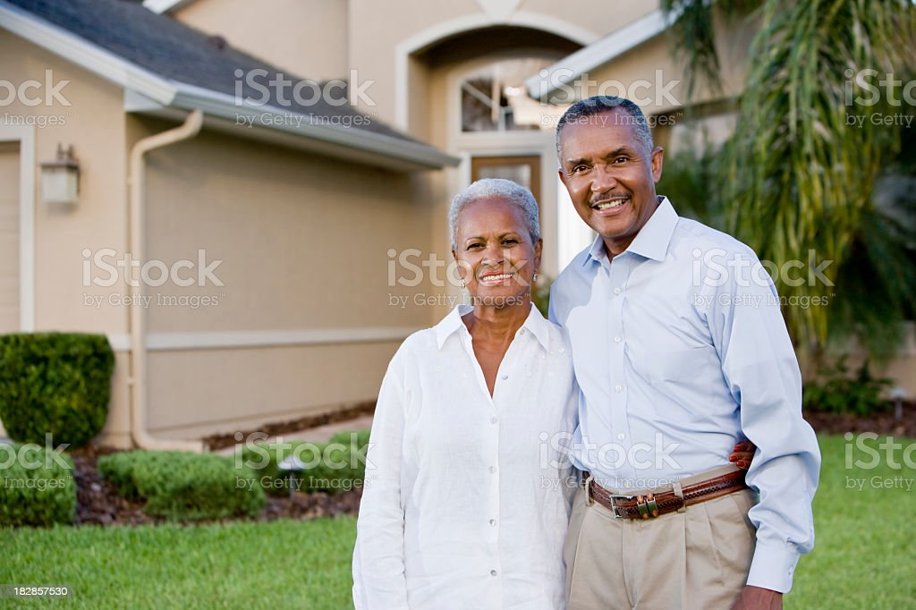 Portrait of happy African American couple standing outside home stock photo