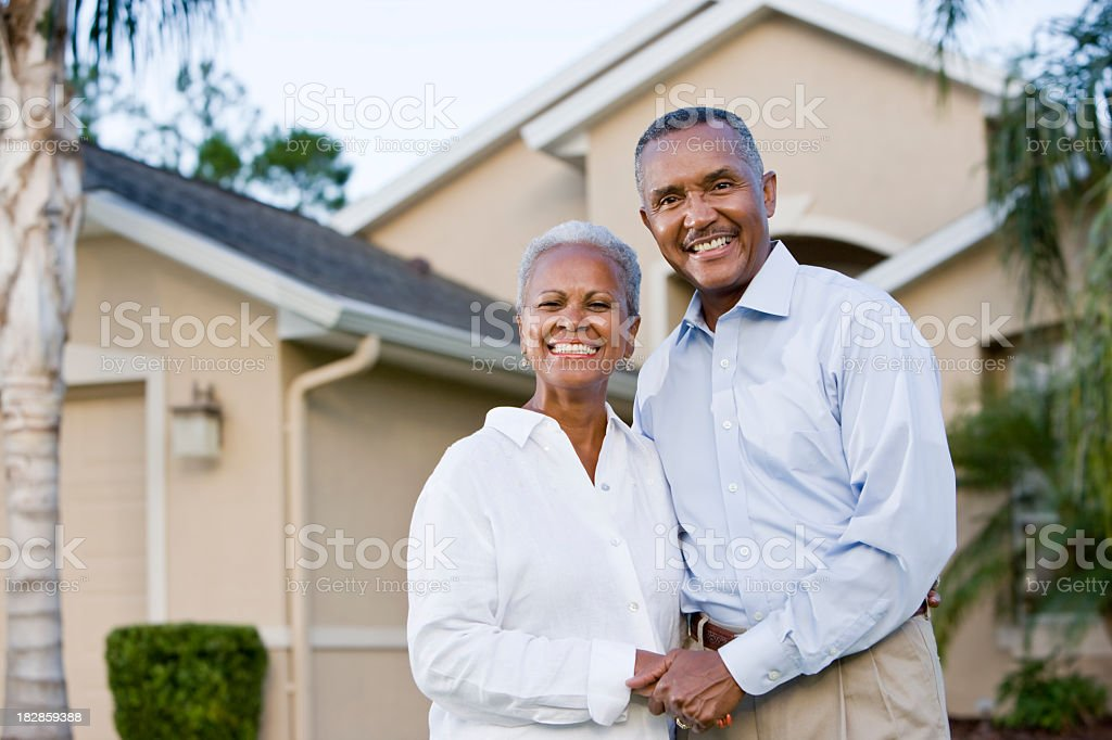 Portrait of happy African American couple standing outside home royalty-free stock photo