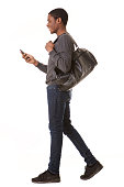 istock portrait of happy african american man walking with mobile phone and bag 1036190066