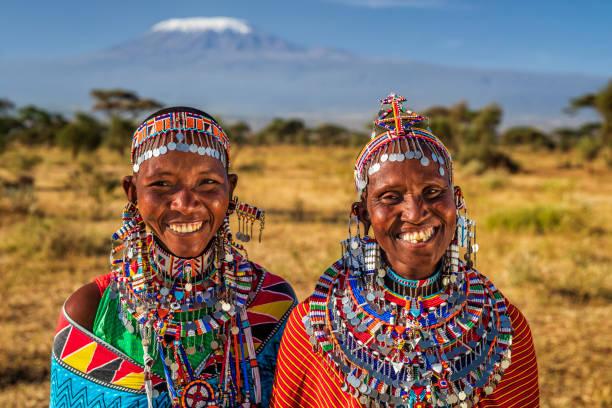 Portrait of happy African women, Mount Kilimanjaro on the background, Kenya, East Africa stock photo