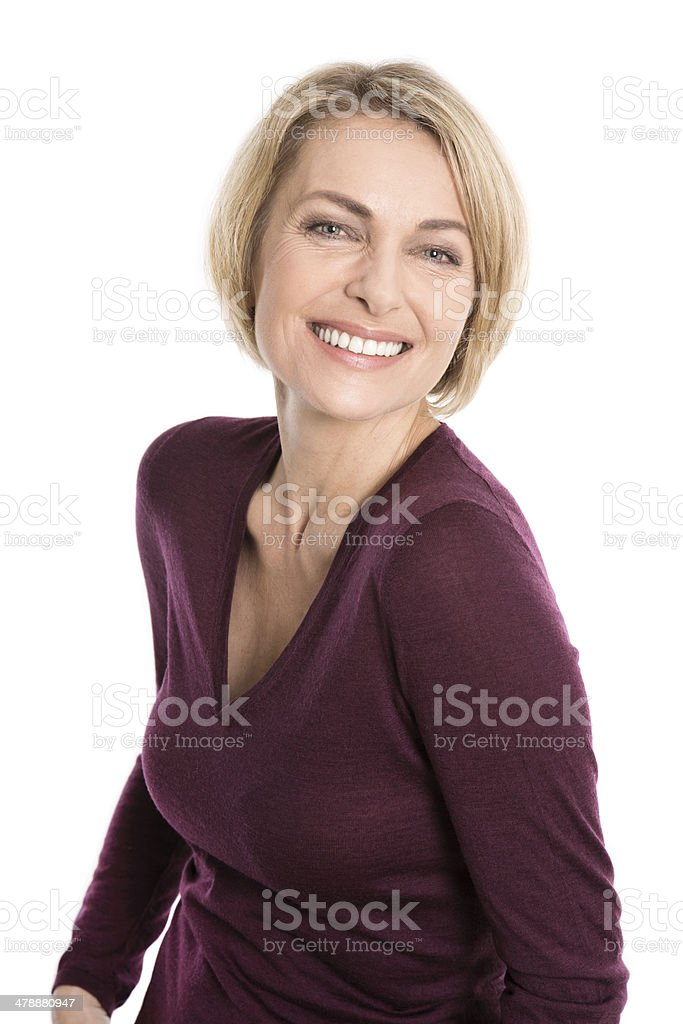 Portrait of happy aged woman over white background stock photo