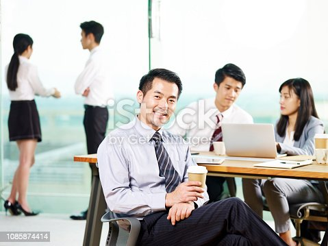 960195072 istock photo portrait of happy aisan business man 1085874414