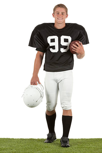 Portrait of happy american football player Portrait of happy american football player american football uniform stock pictures, royalty-free photos & images