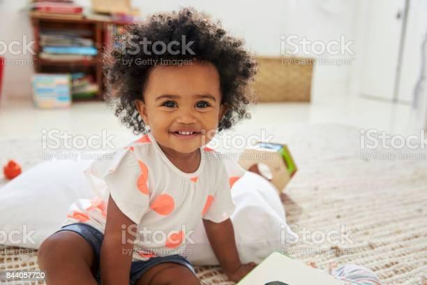 Portrait of happy baby girl playing with toys in playroom picture id844057720?b=1&k=6&m=844057720&s=612x612&h=3yskmqkcfp7wakix9vm7x1xbzrrmbrhfo41qdoqkglw=