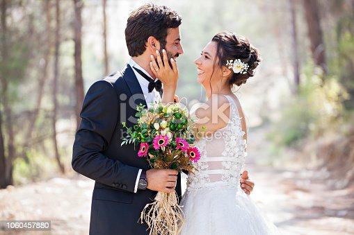 Portrait of happy bride and groom outdoor in nature.